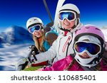 Skiing, ski lift, winter - skiers on ski lift - stock photo