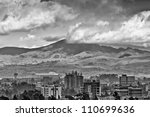 A view of the city of Addis with mountains in the background - stock photo