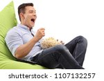 young guy seated on a beanbag... | Shutterstock . vector #1107132257
