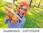 baby boy in orange helmet pilot ...   Shutterstock . vector #1107152243