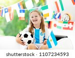 child watching football game on ... | Shutterstock . vector #1107234593