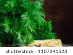 fresh dill on the old wooden... | Shutterstock . vector #1107241523