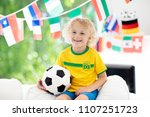 child watching football game on ... | Shutterstock . vector #1107251723