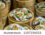 bamboo steamers with oyster | Shutterstock . vector #1107256523