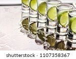 alcohol. close up tequila shot... | Shutterstock . vector #1107358367