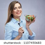 smiling young woman holding... | Shutterstock . vector #1107450683