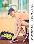 tennis player tying shoelaces... | Shutterstock . vector #1107524723