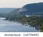 River shore with a factory and boats parked nearby - stock photo