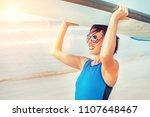 surfer woman with longboard | Shutterstock . vector #1107648467