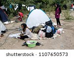 refugees and migrants in a... | Shutterstock . vector #1107650573