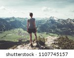 athletic fit young woman hiker... | Shutterstock . vector #1107745157