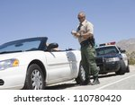 Full length of traffic officer writing ticket - stock photo
