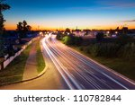 Light trails of evening highway. Urban background - stock photo