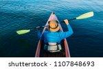 man kayaking  swinging paddle...   Shutterstock . vector #1107848693