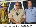 Portrait of a firefighter, traffic cop and EMT doctor standing together - stock photo