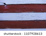 wooden wall painted in red and... | Shutterstock . vector #1107928613