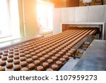 baking production line. raw... | Shutterstock . vector #1107959273