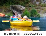child with paddle on kayak.... | Shutterstock . vector #1108019693