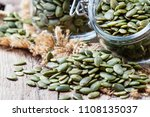 raw pumpkin seeds  healthy... | Shutterstock . vector #1108135037