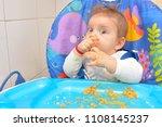 9 month children  eating pasta... | Shutterstock . vector #1108145237