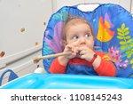 7 month children  eating a bone ... | Shutterstock . vector #1108145243