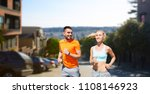 Small photo of fitness, sport and healthy lifestyle concept - smiling couple with heart-rate watch running over san francisco city background