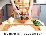 female hands making dough for...   Shutterstock . vector #1108306697