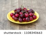 yellow plate with fresh picked... | Shutterstock . vector #1108340663