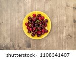 yellow plate with fresh... | Shutterstock . vector #1108341407