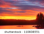 Sunrise on lake - stock photo