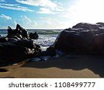 stony shore with view of beach | Shutterstock . vector #1108499777