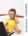 Little girl using modern communication tools - stock photo