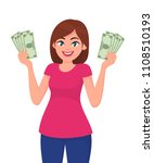 young woman holding cash money... | Shutterstock .eps vector #1108510193