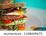 avocado on toast with eggs and... | Shutterstock . vector #1108609673