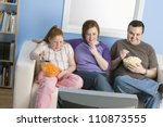 Family Watching Television - stock photo