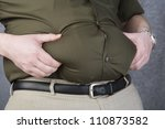 Obese Man Grabbing His Fat On The Stomach - stock photo