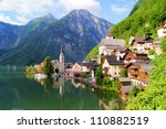 Famous lake side view of Hallstatt village with Alps behind, Austria - stock photo