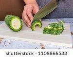 a woman s hands cutting bitter... | Shutterstock . vector #1108866533