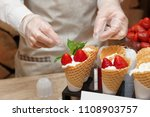 pastry chef is decorating ice... | Shutterstock . vector #1108903757