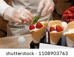 pastry chef is decorating ice... | Shutterstock . vector #1108903763
