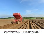 planting potatoes with a... | Shutterstock . vector #1108968383
