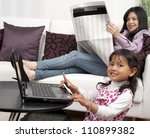 Mother and Girl in the home - stock photo