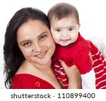 Loving mother holding baby in the house - stock photo