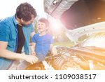happy father and son repairing... | Shutterstock . vector #1109038517