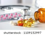 colored pills poured from a... | Shutterstock . vector #1109152997