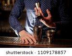 bartender hand pouring a... | Shutterstock . vector #1109178857