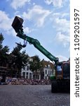 Small photo of Deventer, Netherlands - July 12, 2014: Act with crane during 'Deventer on Stilts'