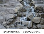 waterfall over rocks | Shutterstock . vector #1109292443