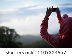 woman hiker taking photo with... | Shutterstock . vector #1109324957