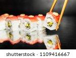 chopsticks holding sushi roll... | Shutterstock . vector #1109416667